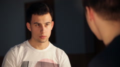 Two young men talking to each other - stock footage