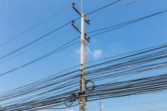 Electrical wires on power pole, Thailand Stock Photos