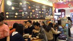Busy trendy Korean restaurant in Shanghai, China Stock Footage