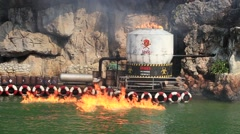 Burning of oil in water during Spy war show in Safari World. Bangkok, Thailand - stock footage