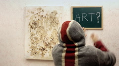 Art exhibit vandal writing blackboard Stock Footage