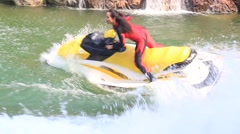 Thai girl riding a jet ski in Spy war show in Safari World. Bangkok, Thailand - stock footage