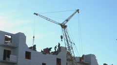 Construction of an apartment building. Crane Stock Footage