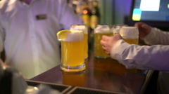 Waiter taking two glasses of beer from table Stock Footage