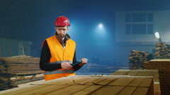 Warehouse worker uses a tablet, according to the quantity of goods or - stock footage