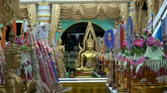 Zoom Out From A Buddha Image To Worshipers Stock Footage