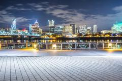Empty brick floor with cityscape and skyline of portland at night Stock Photos