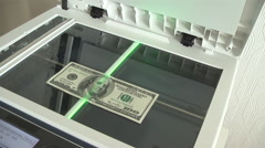 photocopy of hundred dollar bills on a copier - stock footage