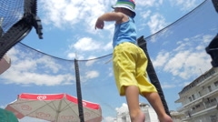 Little child having fun on tramp outdoor Stock Footage