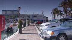 Estepona port - club house pan to port Stock Footage
