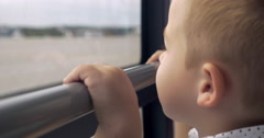 Smiling Boy Looking out the Bus Window Stock Footage