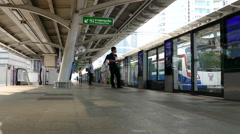 People waiting for the BTS train at Chong Nonsi BTS Station Stock Footage