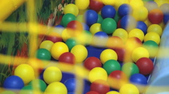 Child riding on a roller coaster at a games room Stock Footage