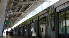 People leaving the BTS train at Chong Nonsi BTS Station at Sathon Distric Stock Footage