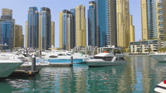 Yacht moored in city harbor - stock footage