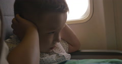 Kid shutting ears at the airplane Stock Footage