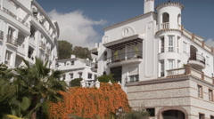 Short pan across to a lrge Mijas town villa - stock footage