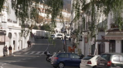 Mijas street from the shade of trees Stock Footage