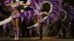 Carnival dancers present their carnival costumes during a carnival in Spain Stock Footage