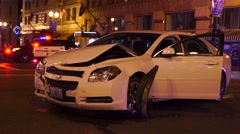 Crashed Car At Night With Police In The Background And Emergency Lights Flashing - stock footage
