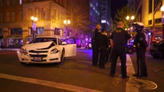 Crashed Car With Police On Scene At Night - stock footage