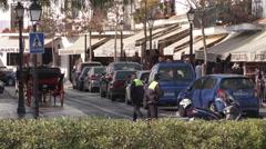 Mijas square with traffico police on patrol Stock Footage