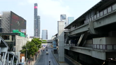 Traffic next to the Chong Nonsi BTS Station at Sathon District in Bangkok Stock Footage