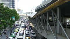 Traffic and the skywalk at Sathon District in Bangkok Thailand Stock Footage