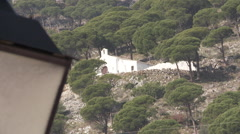 Mijas hill church and streetlamp foreground - stock footage