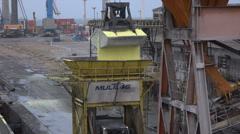 Grab releases cargo from ship to truck, Fortaleza harbour, Brazil Stock Footage