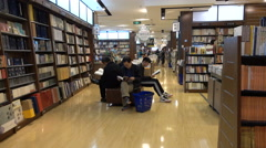 People read books in a large bookstore in Shanghai, China Stock Footage