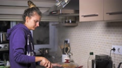 Woman is cooking in the kitchen Stock Footage