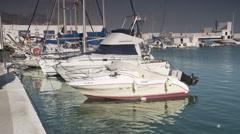 Fuengirola port boats tilt and pan Stock Footage