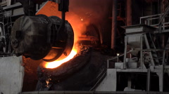 Transfusion of iron from the ladle into a basic oxygen furnace to purge - stock footage