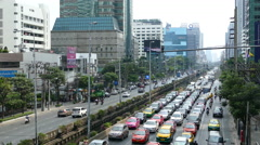 Traffic at Sathon Tai Road and Sathon Nuea Road in Bangkok Thailand Stock Footage