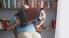 Playing the accordion Stock Footage