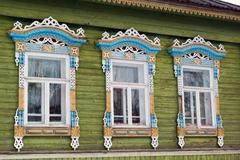 Carved window in old russian wooden country house - stock photo