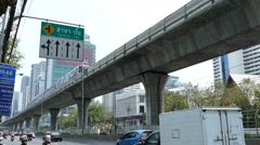 Traffic and BTS at Sathon Tai Road and Sathon Nuea Road in Silom Bangkok Stock Footage