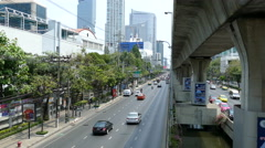Traffic at Sathon Tai Road and Sathon Nuea Road in Silom Bangkok Stock Footage