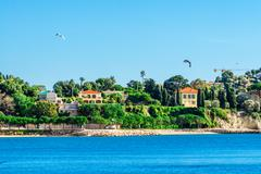 Panoramic view of coastline and beach with blue sky, luxury resort and bay wi - stock photo