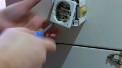 Workers install socket Stock Footage