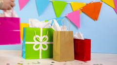 Gift bags at the kids Birthday party on the table. - stock footage