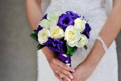 Bride hold wedding bouquet with white and lilac roses - stock photo