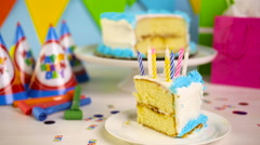 Simple white Birthday cake slice with white and blue icing. Stock Footage