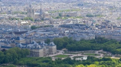 Aerial view of the Luxembourg gardens and Notre-Dame de Paris Stock Footage