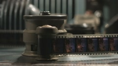 Film close up start rolling in old film editing equipment (1) Stock Footage