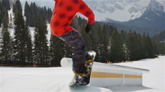 Freestyle snowboarder boardslide slow motion Stock Footage