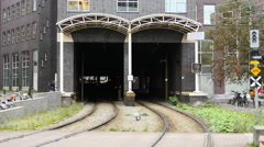 Dutch Tram Exiting Tunnel in Amsterdam Netherlands Stock Footage