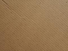 Brown cardboard background - stock photo