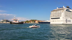 Police boat and cruise liner in Venice Lagoon, Italy, Adriatic sea - stock footage